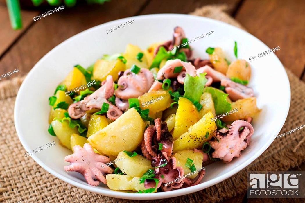 Stock Photo: Potato salad with pickled octopus and green onions.