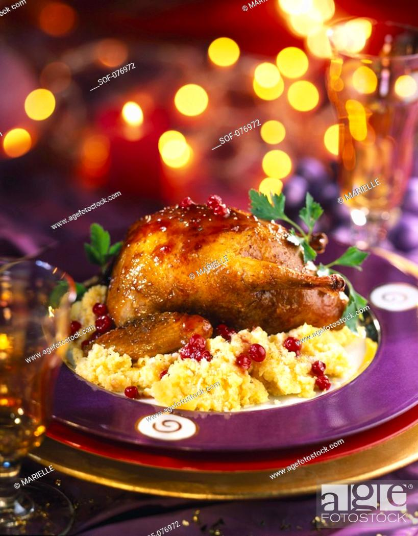 Stock Photo: roast young pigeon and cheese polenta.
