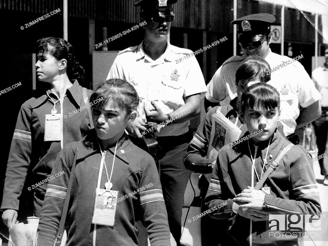 Stock Photo - July 26, 1976 - Montreal, Canada - Gymnast NADIA COMANECI  walks with her teammates and police escorts through the Olympic Village  during the ...