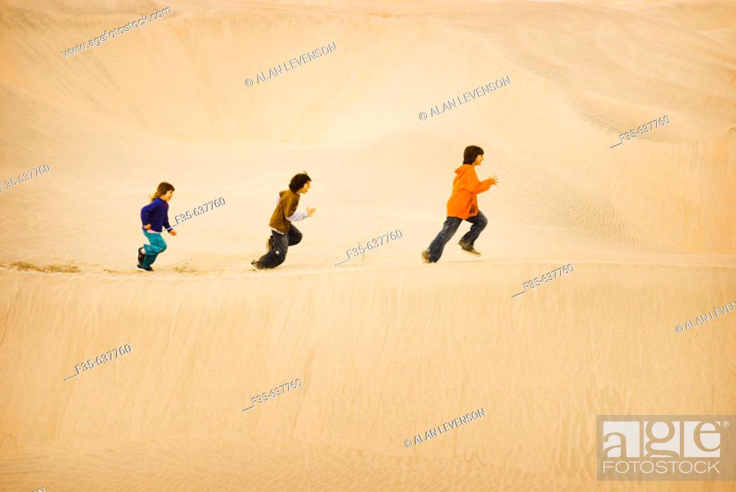 Stock Photo: Children run on Sand Dunes, Baja California, Mexico.