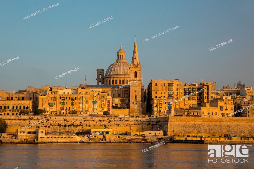 Stock Photo: Dome of carmelite church and St. Paul's Cathedral over water, Valletta, Malta.