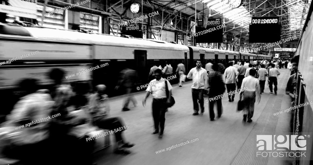 Stock Photo: Group of people at a railway station, Churchgate Station, Mumbai, Maharashtra, India.