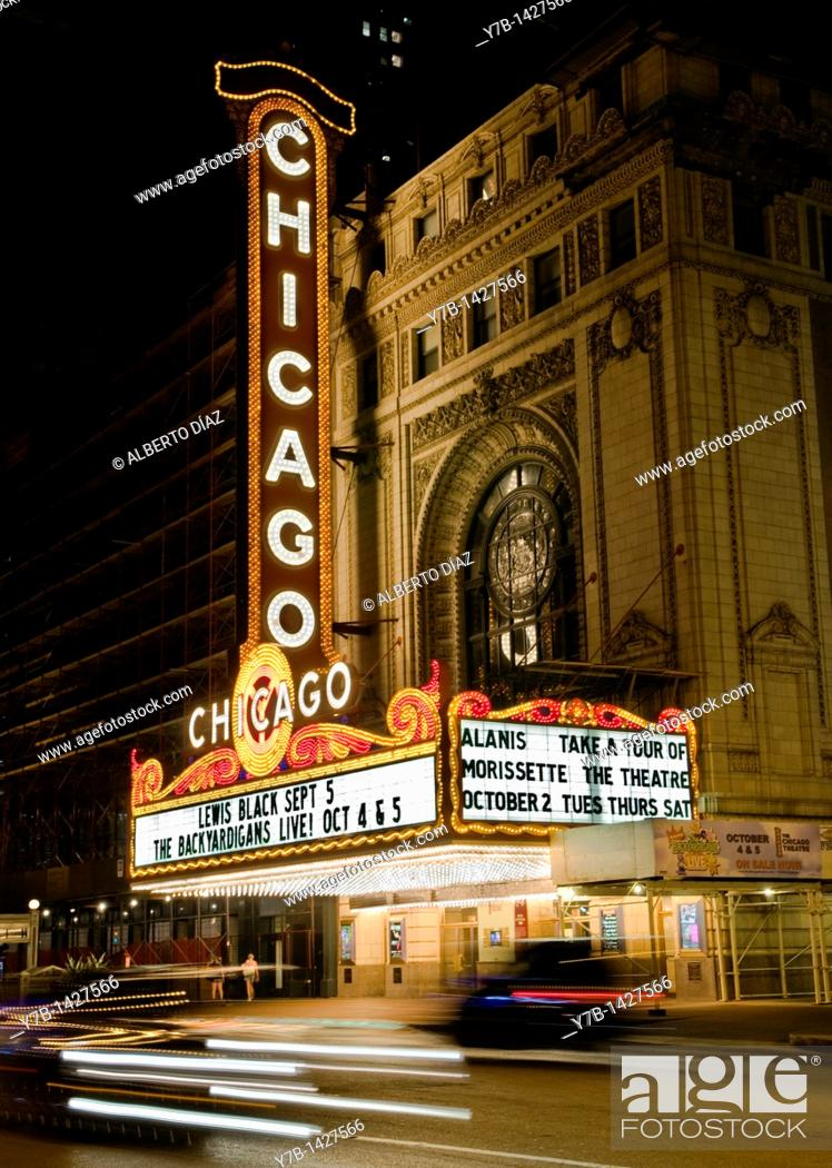 Stock Photo: Traffic in front of the main facade of the Chicago Theatre.