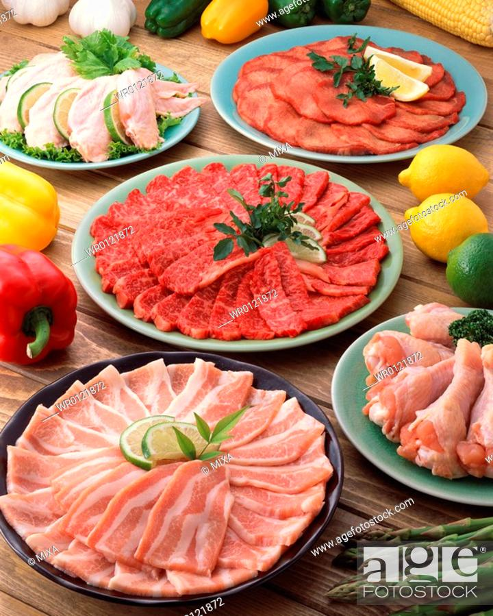 Stock Photo: Assorted fresh meat in plates.