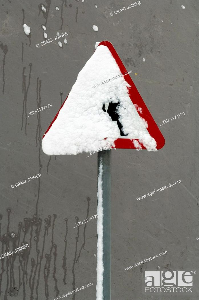 Stock Photo: A school crossing sign covered in snow  Wrington, Somerset, England, United Kingdom.