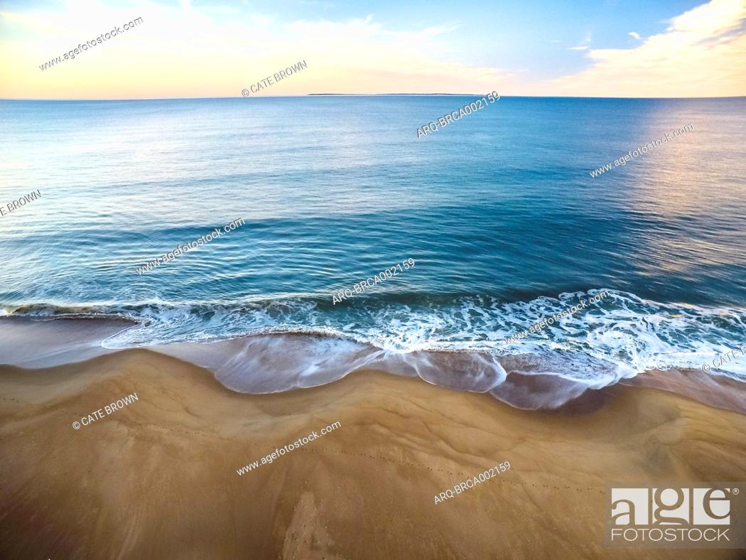 Stock Photo: Aerial drone photography over a Rhode Island beach in winter, during sunset.