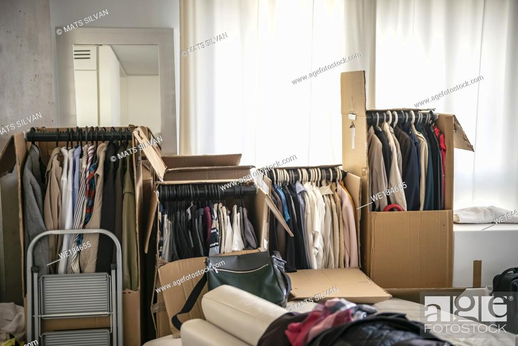 Stock Photo: Clothes in Cardboard Boxes in Switzerland.