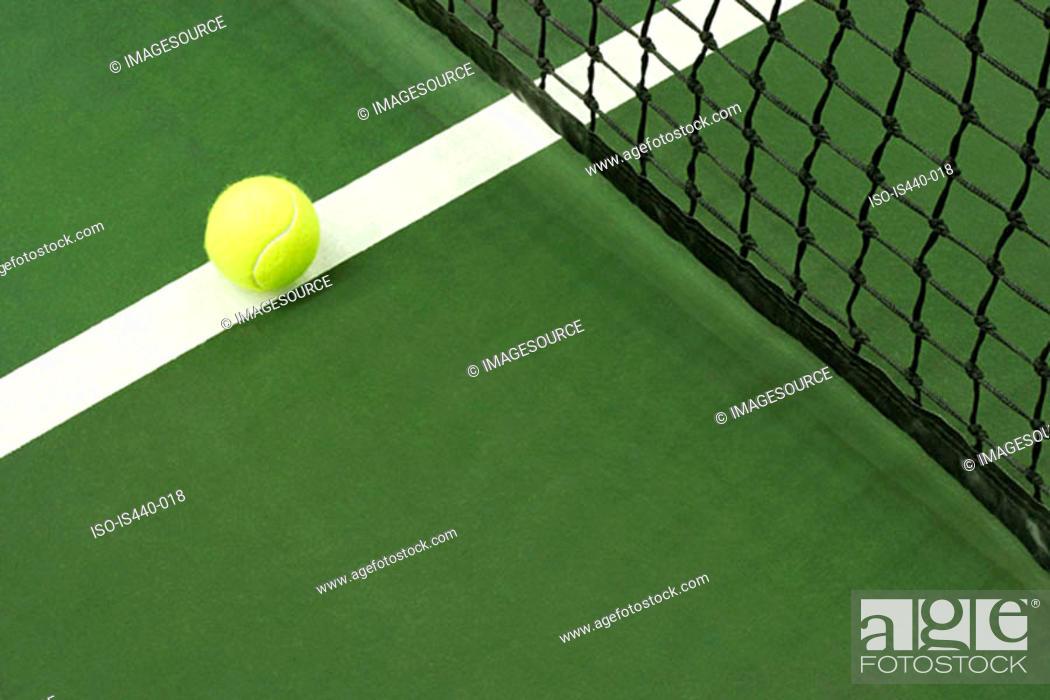 Stock Photo: Tennis ball on court.