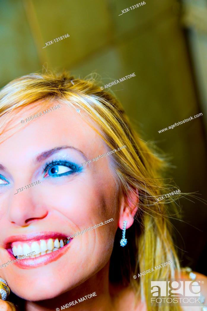 Stock Photo: Portrait close-up of woman smiling.