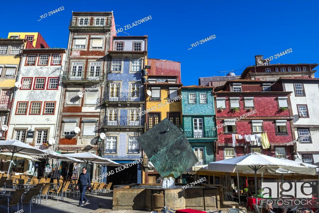 Stock Photo: Tenement houses and Cubo da Ribeira modern sculpture by Jose Rodrigues on Ribeira Square in Porto city, second largest city in Portugal.
