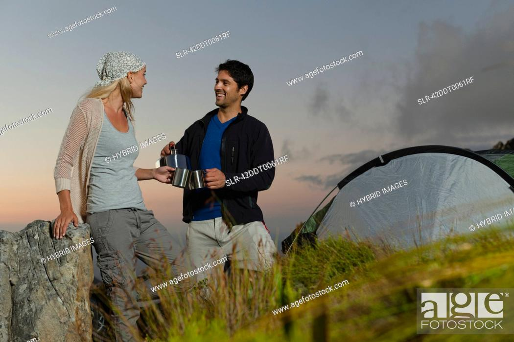 Stock Photo: Couple having tea at campsite.