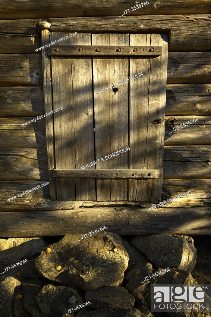 Stock Photo: Front wall of a simple small log cabin in a forest.