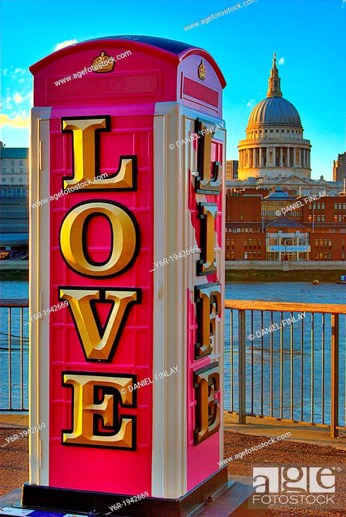 """Stock Photo: Modern art installation telephone box bearing the message """"""""love life"""""""" , on the banks of the River Thames in London, England, with St."""