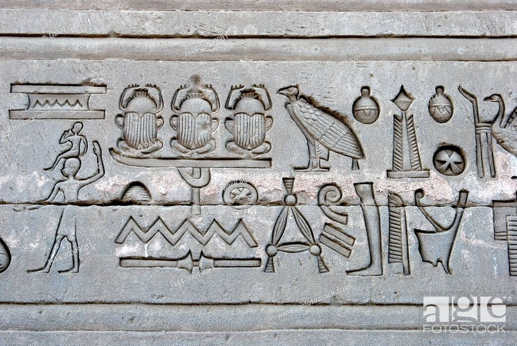 Stock Photo: Egypt, Dendera, Ptolemaic temple of the goddess Hathor.Carvings on external wall.