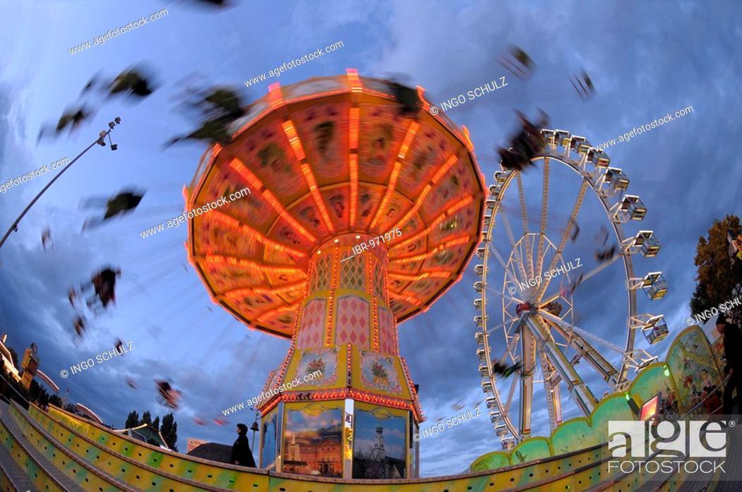 Stock Photo: Swing carousel on a fairground.