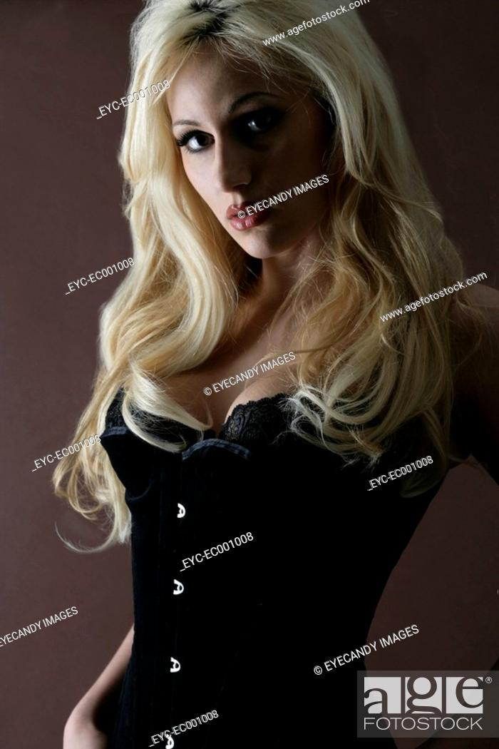 Stock Photo: Portrait of a woman in a bustier.