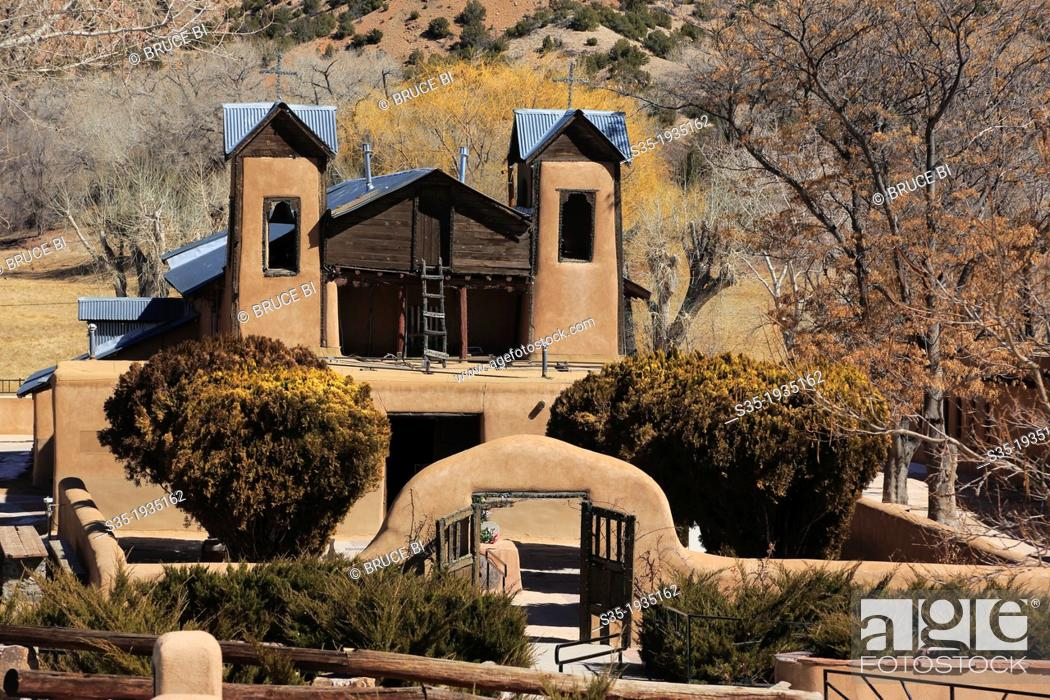 Stock Photo: The historical catholic chapel of Santuario de Nuestro Senor de Esquipulas aka El Santuario de Chimayo. Village of Chimayo. New Mexico. USA.