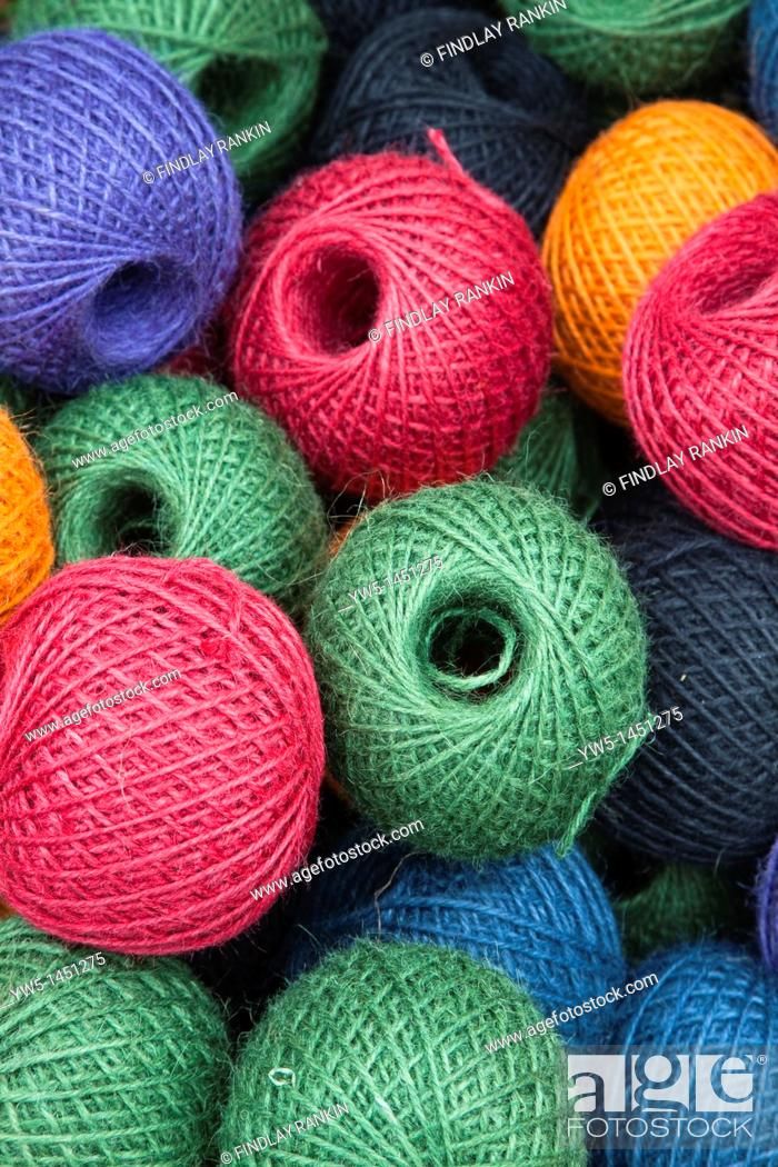 Stock Photo: balls of multicoloured gardening twine in a basket.