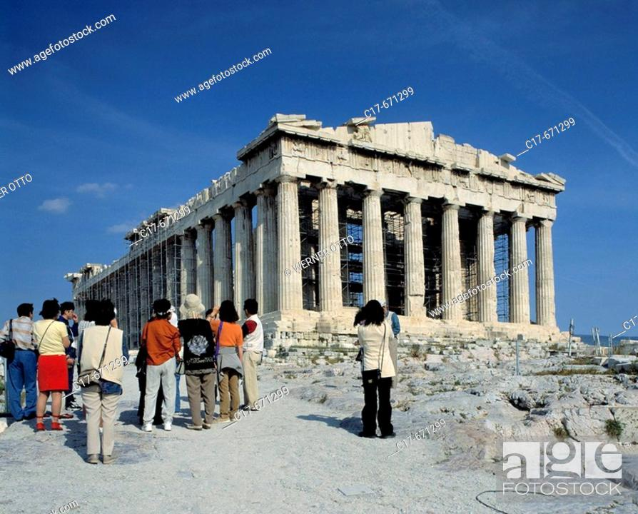 Stock Photo: Greece. Athens, Attica, tourism, group of touists with a travel guide stand in front of the Acropolis, temple, UNESCO, Welterbe, Weltkulturerbe.