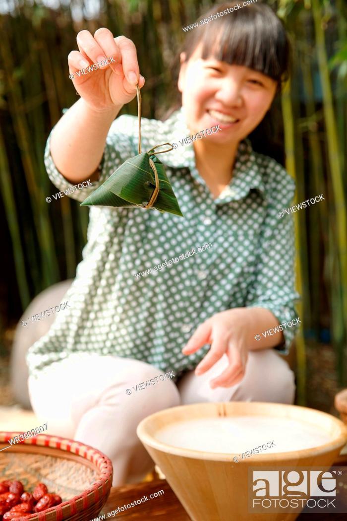 Stock Photo: Middle-aged women are making zongzi.