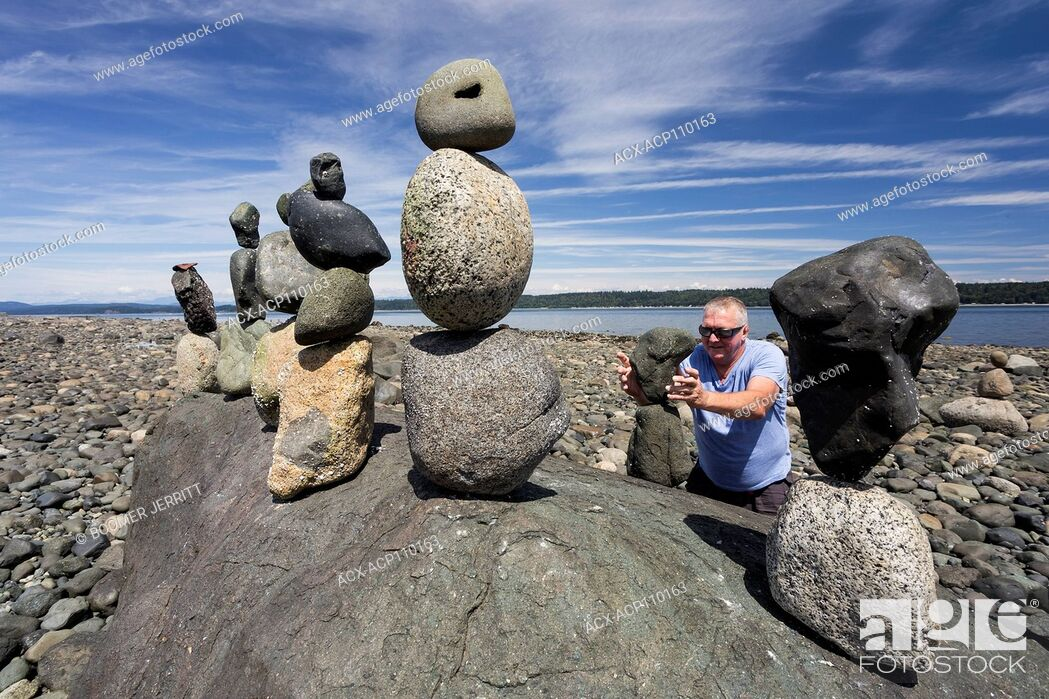 Stock Photo: A practitioner of the art of rock balancing has a field day at low tide along the shores of Discovery Passage, Campbell River, Vancouver Island.