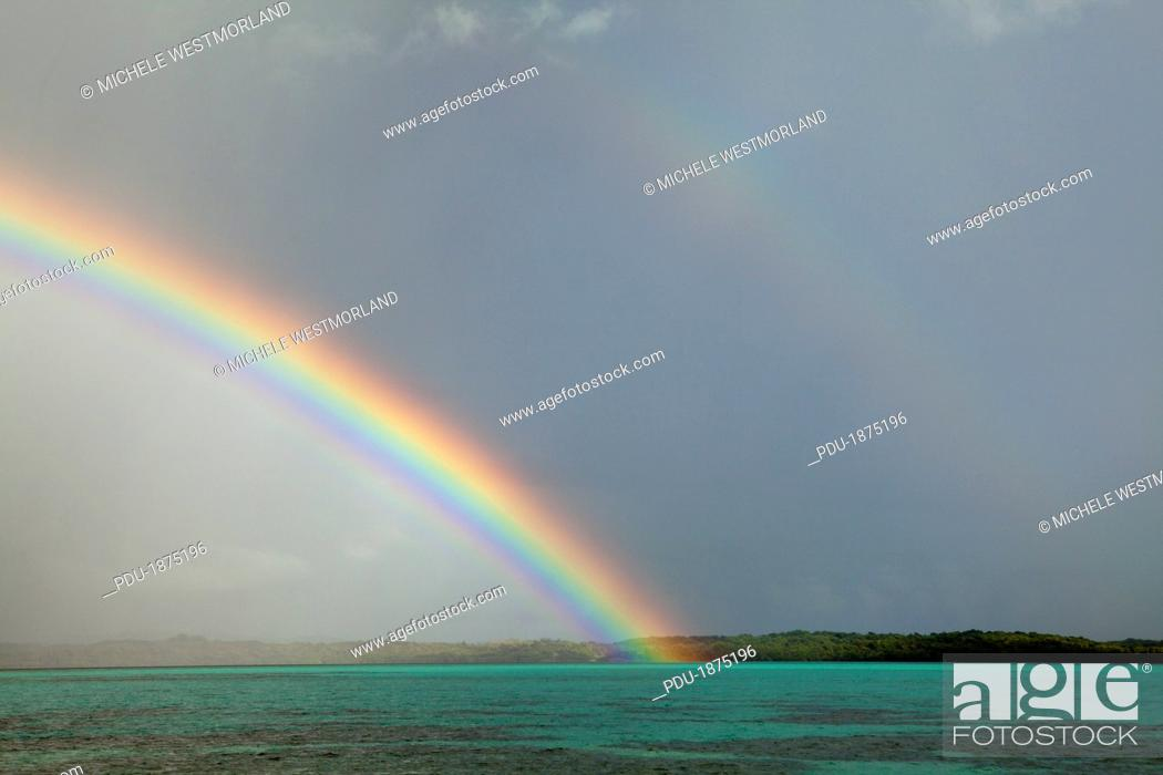 Stock Photo: Rainstorm and rainbow near Manta Ray Bay Resort on the island if Yap, Federated States of Micronesia.