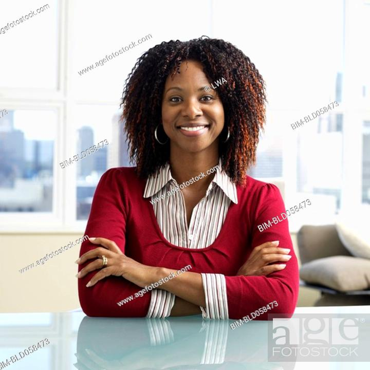 Stock Photo: African businesswoman sitting at table.