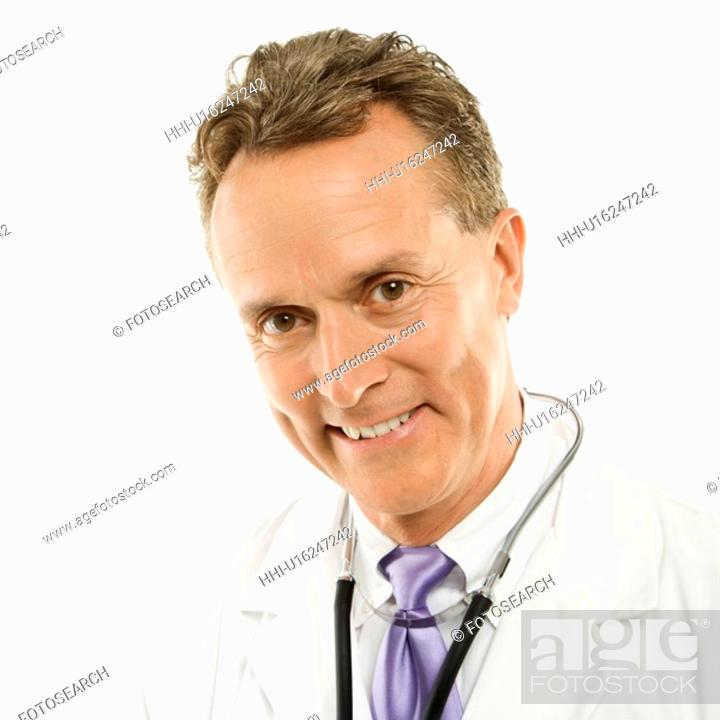 Stock Photo: Portrait of smiling mid-adult Caucasian male doctor with stethoscope around his neck.