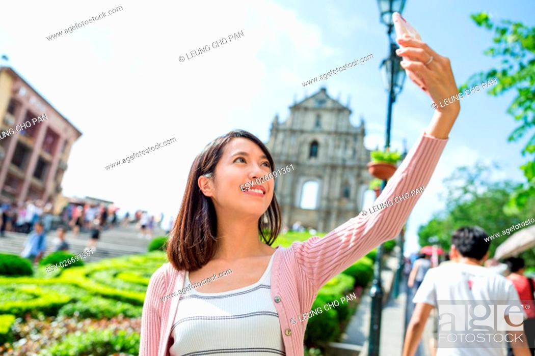 Stock Photo: Woman taking picture by mobile phone.