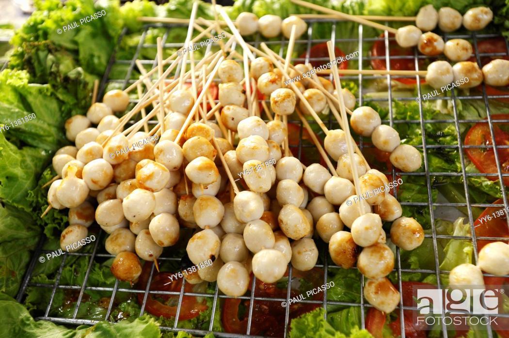 Stock Photo: BBQ mini pork ball on stick, thai street delicacy, bangkok, thailand.