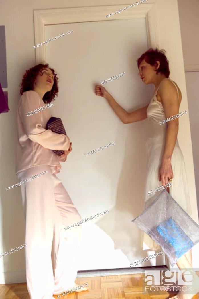 Stock Photo: Women knocking on bedroom door.