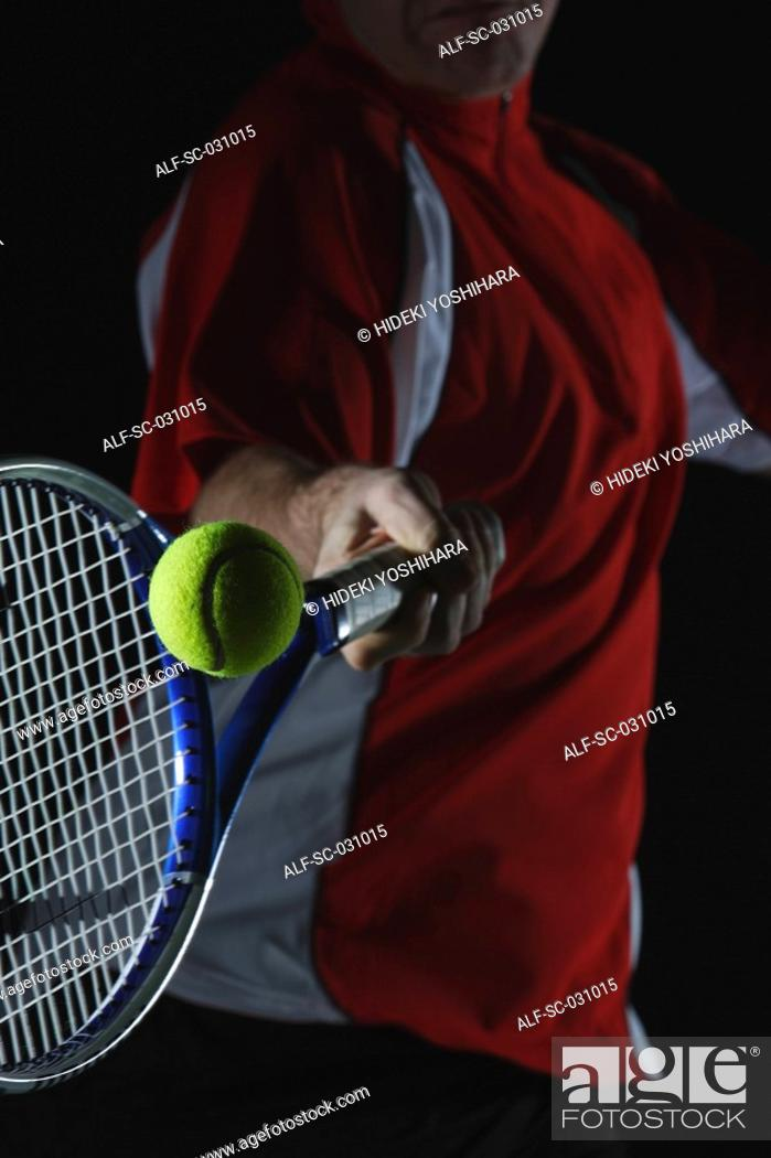 Stock Photo: Tennis Player Swinging at Ball.