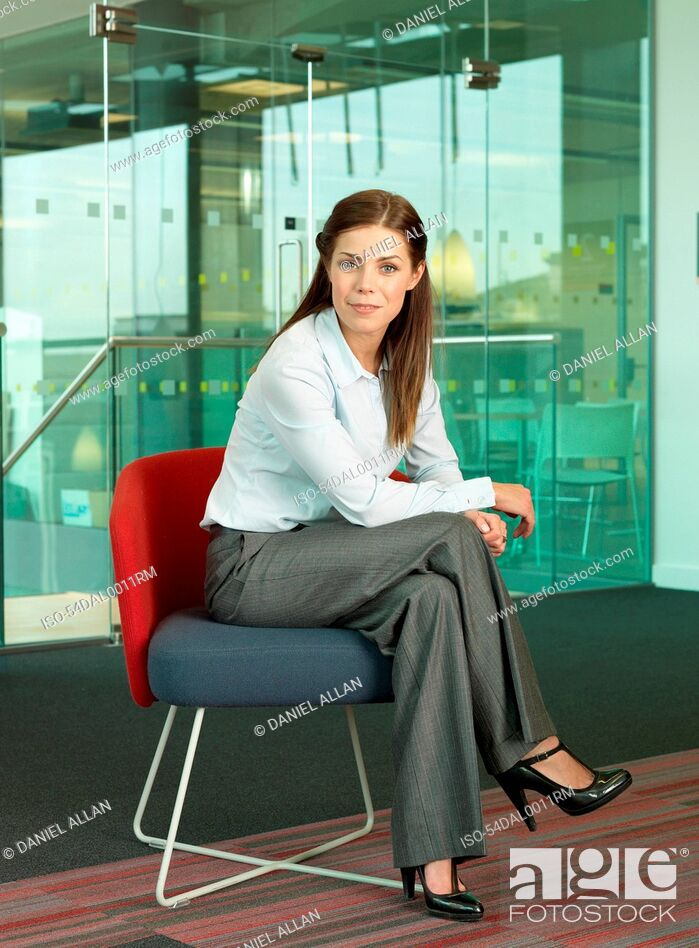 Stock Photo: Businesswoman smiling in chair.