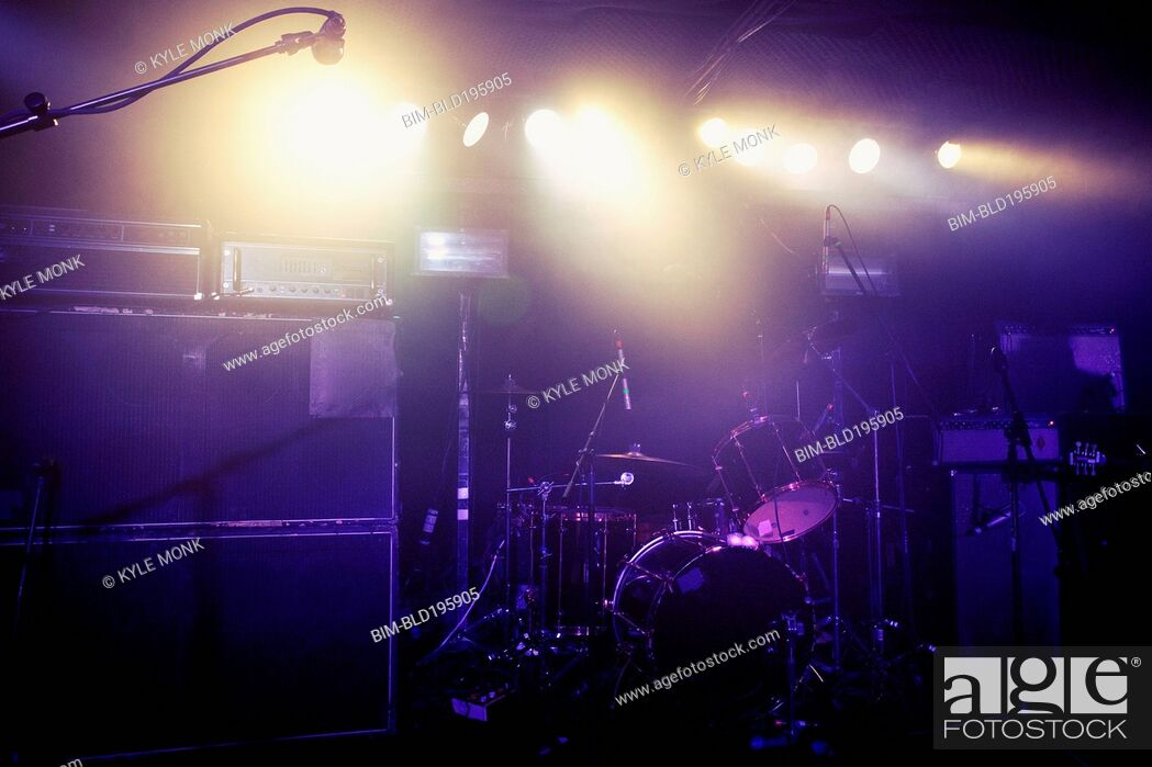 Stock Photo: Drum kit on spotlighted stage.
