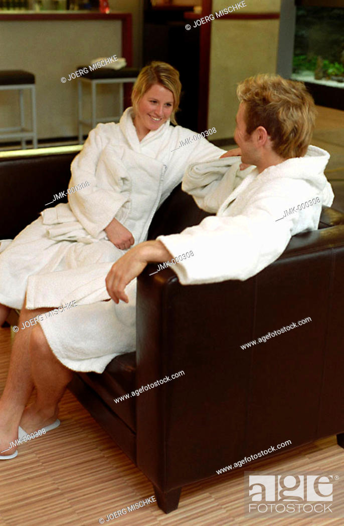 Stock Photo: Young couple, young man, young woman, sitting on a sofa in a lounge of a spa.