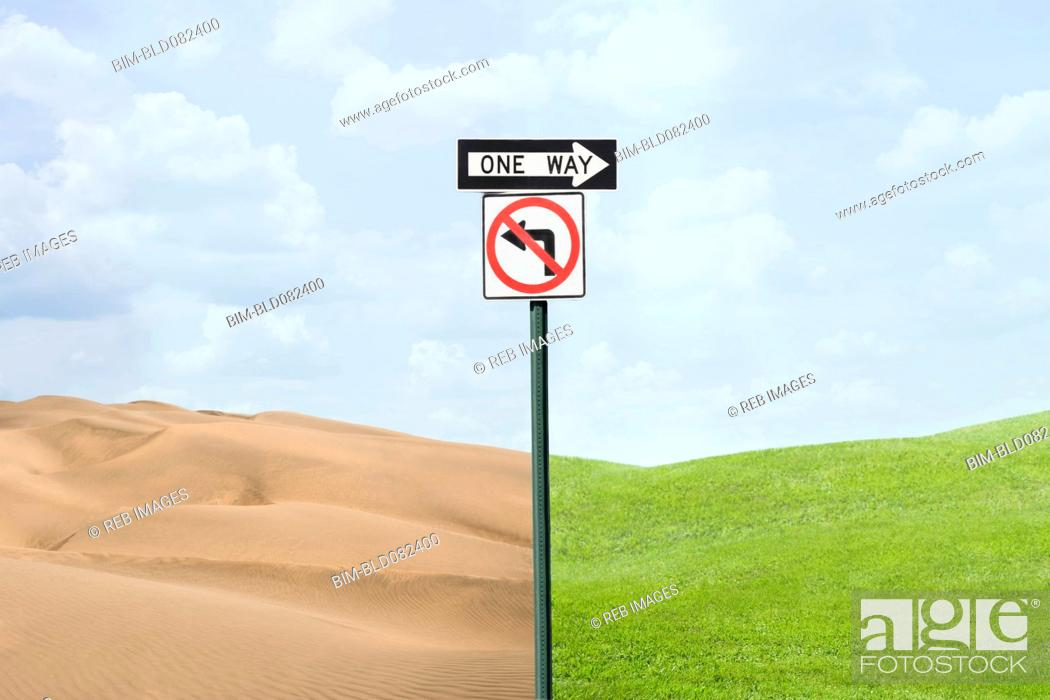 Stock Photo: Road signs pointing at green grass and desert.