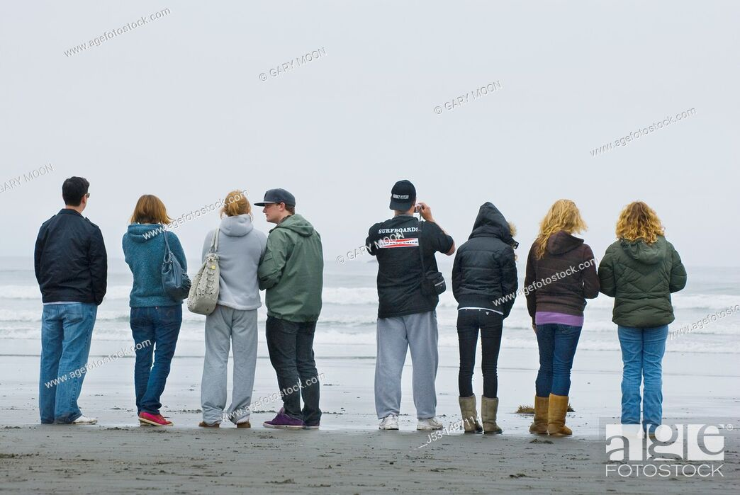 Stock Photo: Young adults watching surfing competition, Crescent City, California.