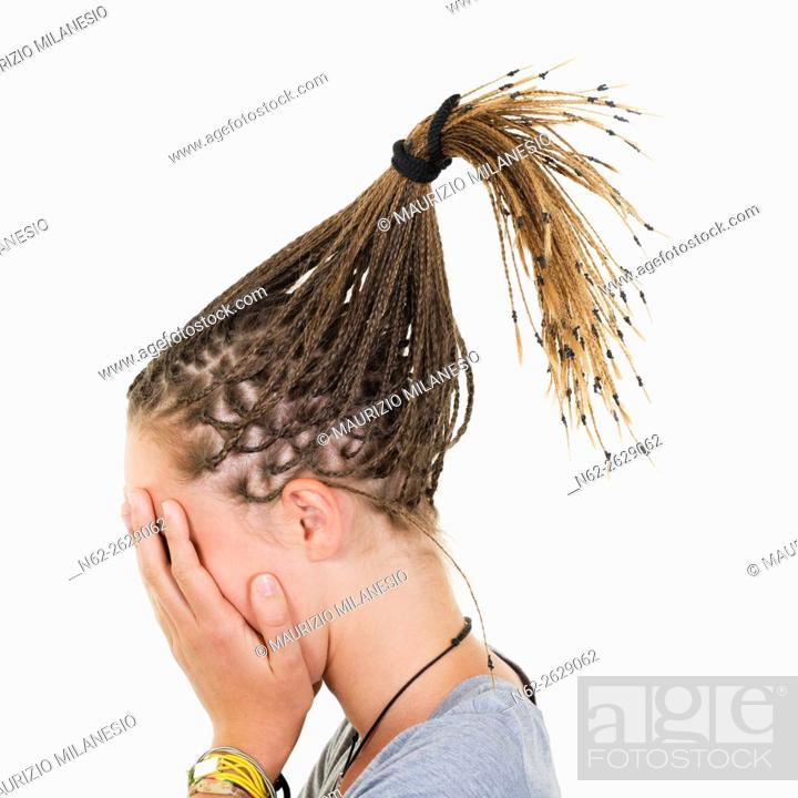 Stock Photo: Blonde girl with braids magically raised, covers her face with her hands.