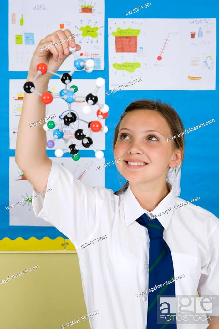 Stock Photo: Girl holding molecule model.