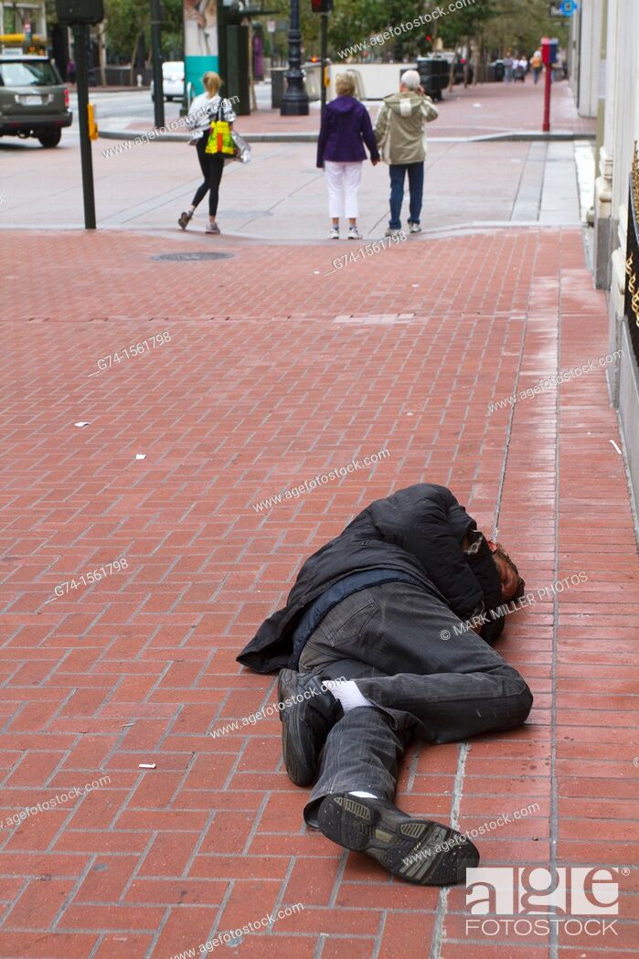 Stock Photo: Street Person Sleeping on Street, San Francisco, California, USA.