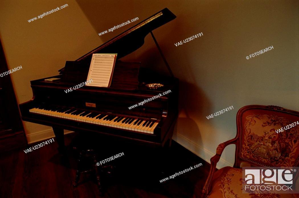 Stock Photo: Grand Piano In Corner.