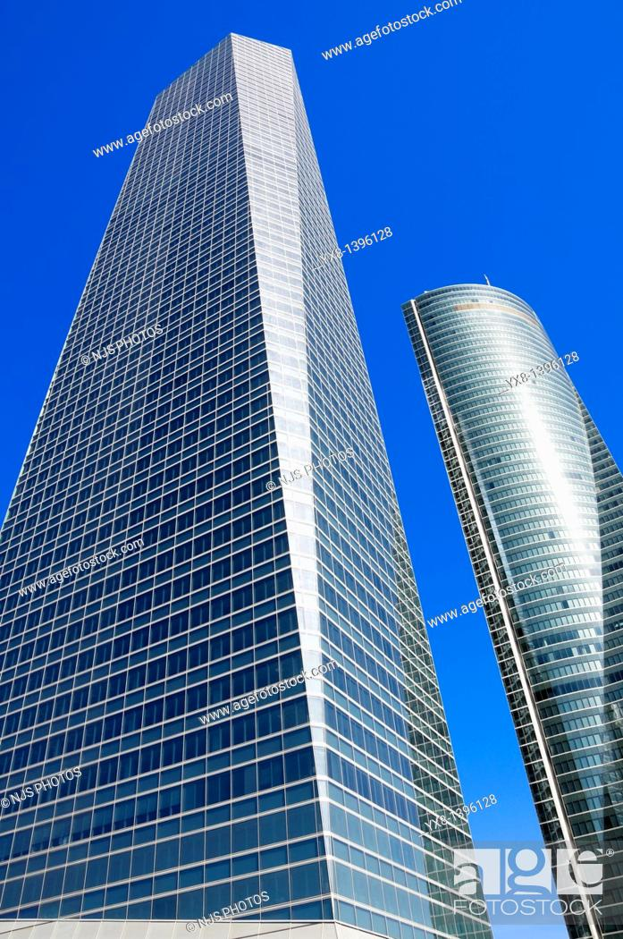 Stock Photo: View from below of Crystal Tower and Espacio Tower located in Cuatro Torres Business Area of Madrid, Comunidad de Madrid, Spain, Europe.