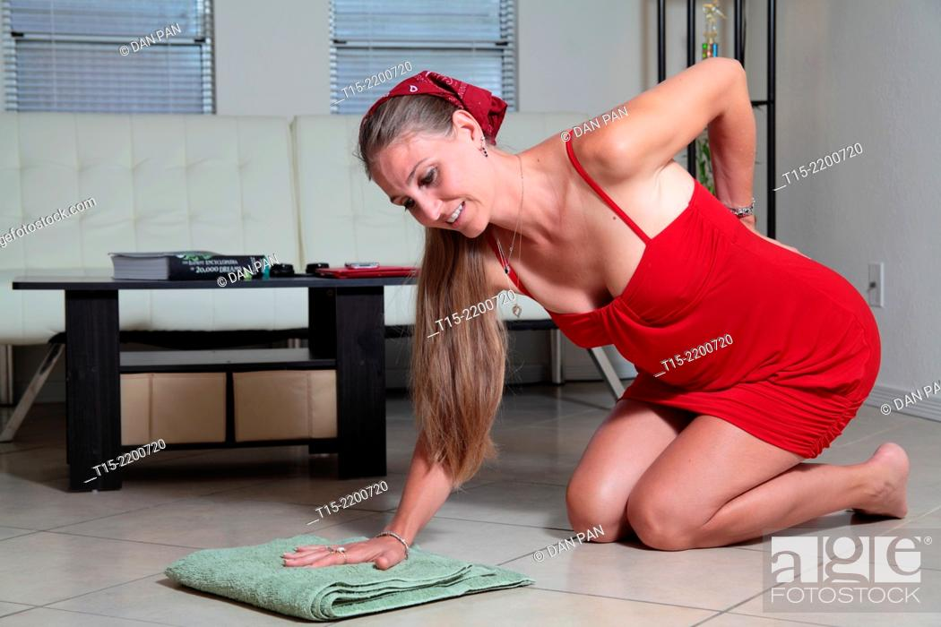 Stock Photo: A woman mopping the floor getting hurt.