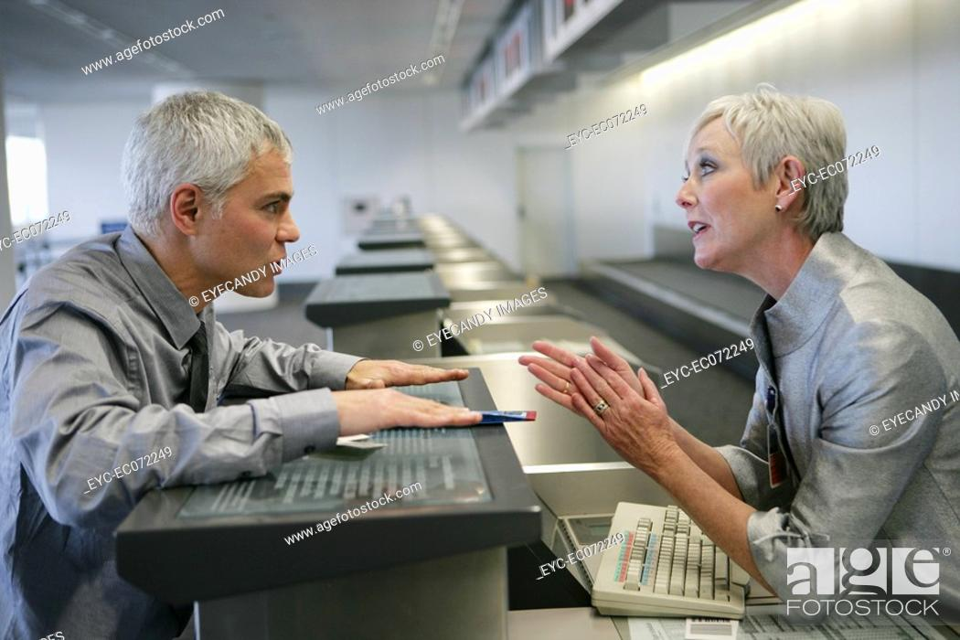 Stock Photo: Stressed man checking in at airport.
