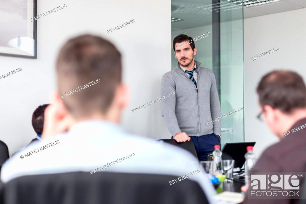Stock Photo: Team manager and business owner leading in-house business meeting. Business and entrepreneurship concept.