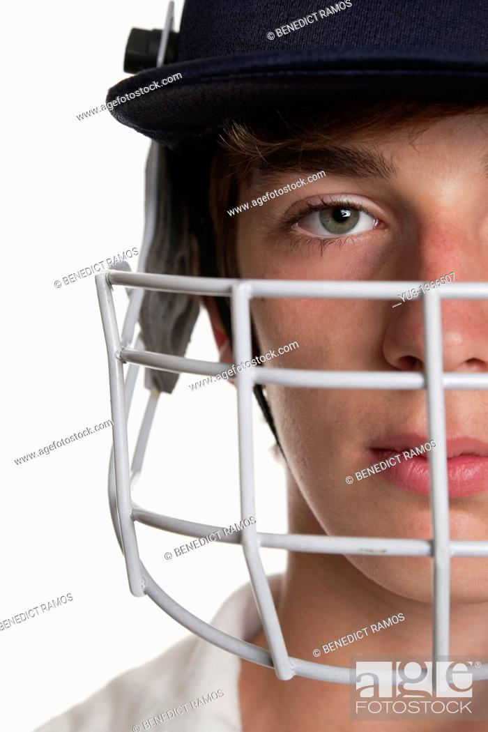 Stock Photo: Portrait of teenage cricketer in protective helmet and visor.