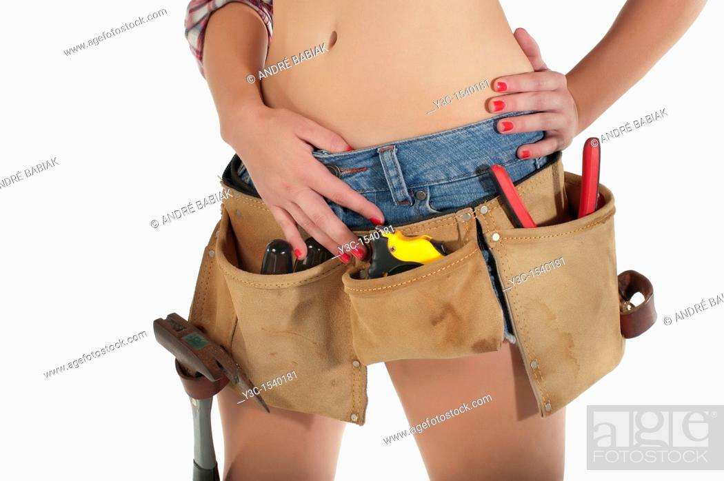 Stock Photo: Tool belt on sexy female body.