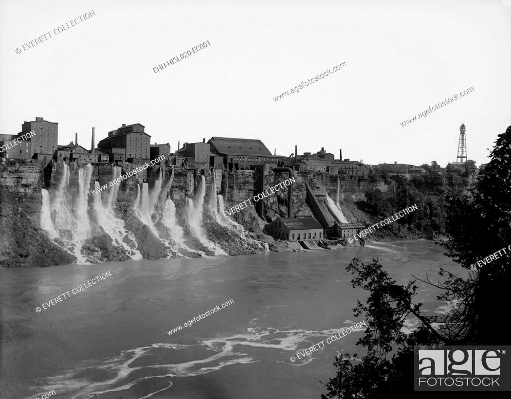Stock Photo: A cluster of factories built on and into the walls of the Niagara River Gorge. Water diverted from above the great Niagara Falls flows from the factories power.