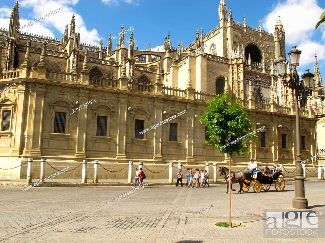 Stock Photo: Activity; Adult; Andalusia; Architecture; Art; Building; Carriage; Cathedral; Celebration; City; Clear Sky; Color Image; Costume; Day; Driver; Europe;.