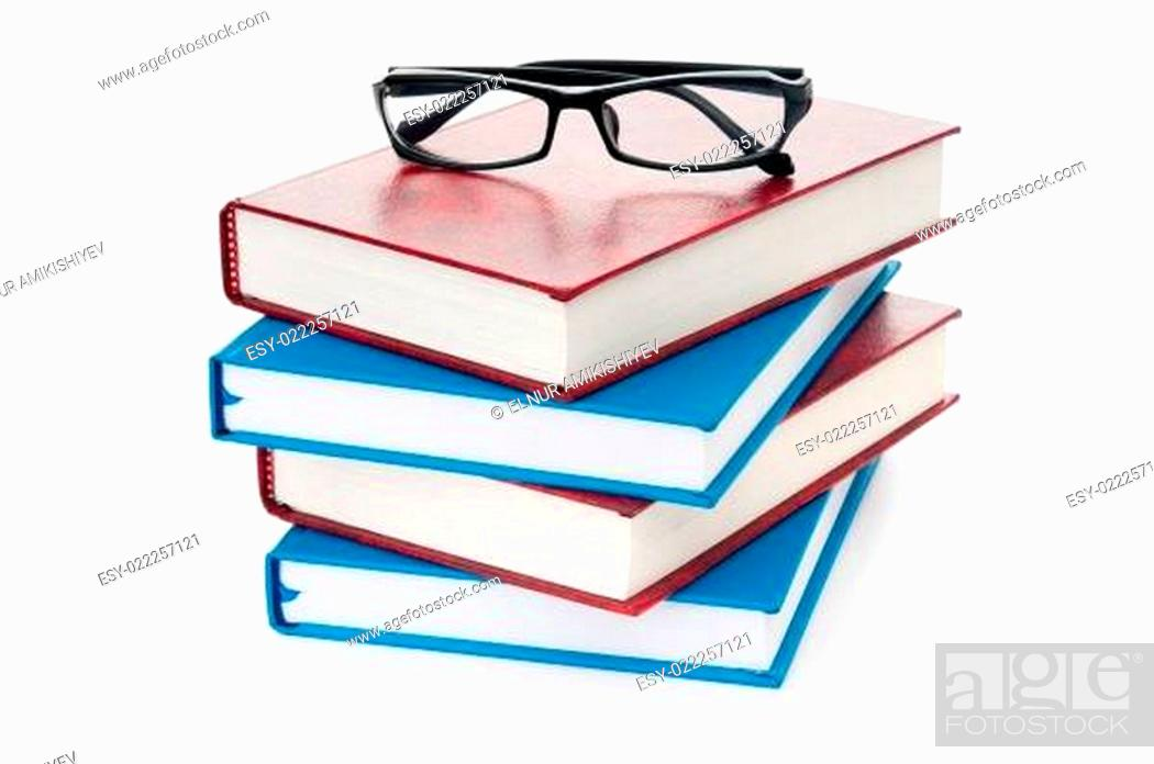Imagen: Reading glasses with books isolated on the white.